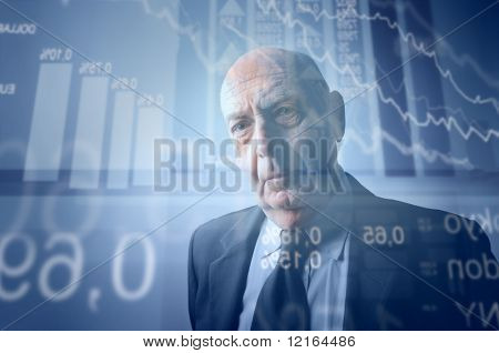 Businessman with stock exchange graphics on the background