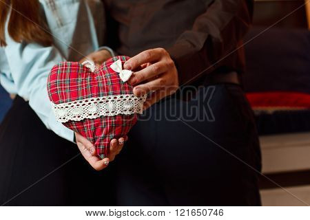 A Couple In Love Holding Red Heart