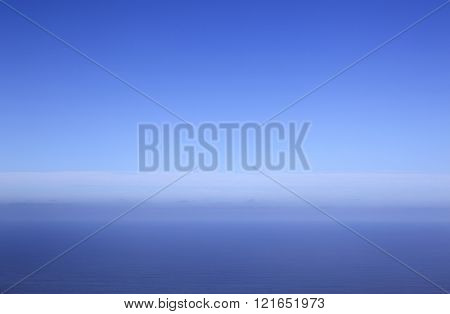 expanse of blue sea and sky with clouds above atlantic ocean seen from tenerife north