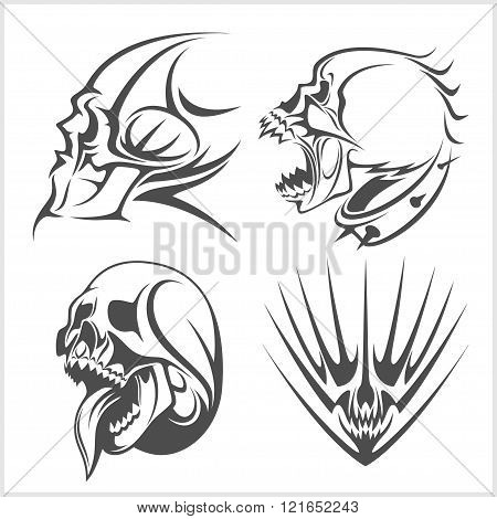 Skulls with tribal elements vector set.