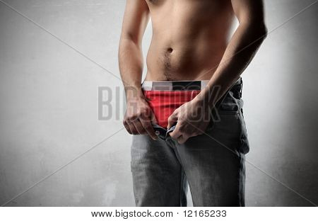 Man taking off his pants