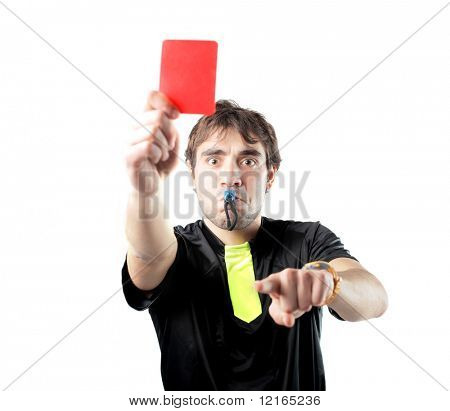 Referee whistling and showing a red card