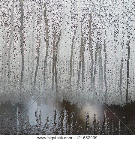 Raindrops On Misty Glass Of Window
