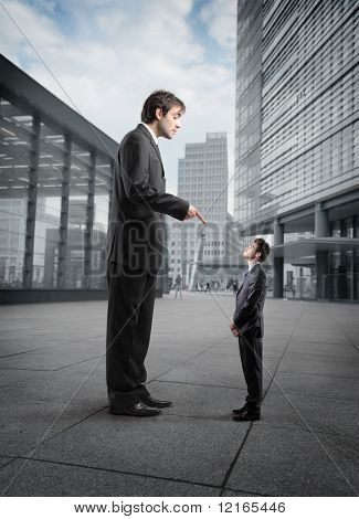 Giant businessman scolding a smaller one