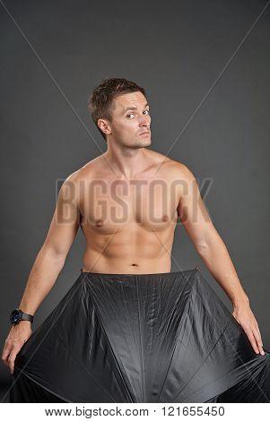 Portrait Of A Sexy Young Man Hidden In Umbrella