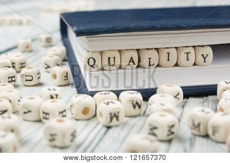 QUALITY  word written on wood block. Wooden ABC