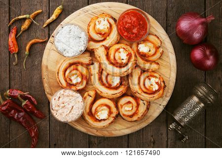 Puff pastry rolls filled with cheese and relish