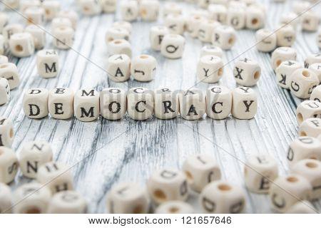 Democracy word written wood block. Wooden ABC