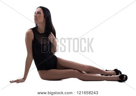slim sexy woman in black lingerie sitting isolated on white