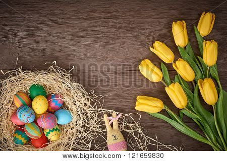 Easter background, eggs, rabbit, yellow tulips