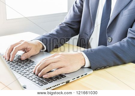 Businessman Typing Or Working With Laptop Or Notebook