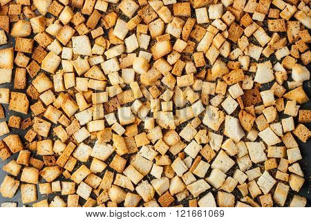Small croutons on a baking tray top view