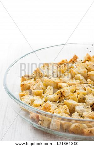 Small croutons with pepper on the glass dish at the right of the table