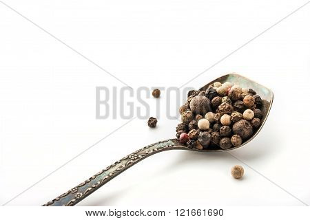 Pepper mix in the vintage metal spoon at the right