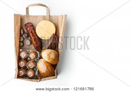 Food mix inside a paper bag on the white background