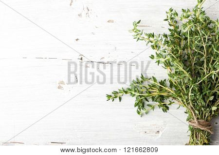 Bundle of thyme on the white board horizontal