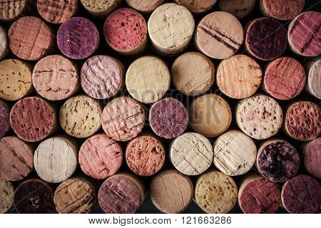 Wine corks red black purple background horizontal