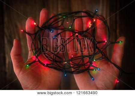 ?olorful decoration festoon in the hands horizontal