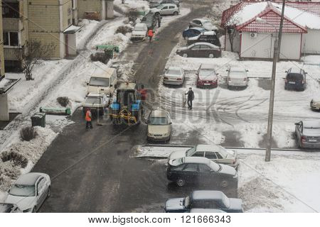 St. Petersburg, Russia - 27 February, Cleaning yards workers and tractor, 27 February 2016.