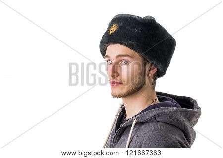 Blond young man with russian fur hat