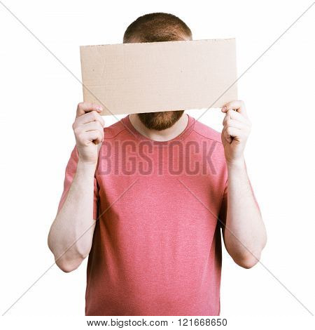 Man Holding A Cardboard Sign