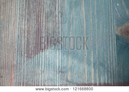 Texture of pine wood table painted in blue