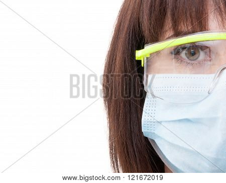 Half Face Of A Dentist Woman Wearing Protection Glasses