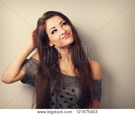 Grimace Confusion Fashion Makeup Brunette Woman Thinking And Looking Up. Toned Vintage Portrait