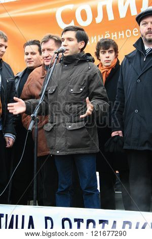 The oppositionist Oleg Kozlovsky speaks at a rally against Putin