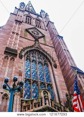 Manhattan, New York city, United States - circa April 2008:Trinity Church with American flag. Confession Episcopal Church located at the intersection of Wall Street and Broadway in the Financial District in Manhattan, New York, United States USA