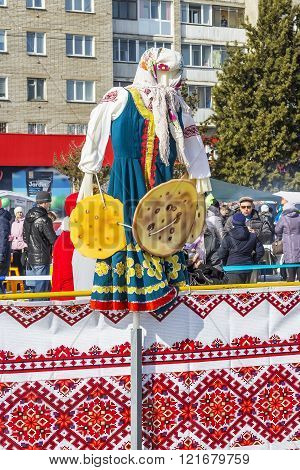 Effigy Of Winter In National Russian Style On The City Holiday Maslenitsa (farewell To Winter)