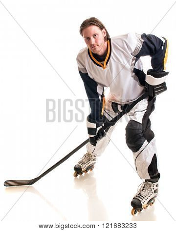Roller hockey player. Studio shot over white.