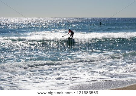 Stand up paddle surfing or standup paddleboarding