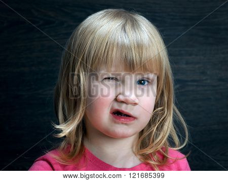 Funny baby, funny facial expressions. Portrait of a little funny girl
