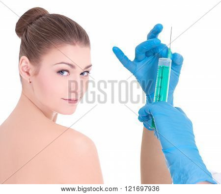 beauty injection concept - hands with syringe and young beautiful woman patient isolated o