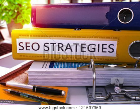 SEO Strategies on Yellow Office Folder. Toned Image.