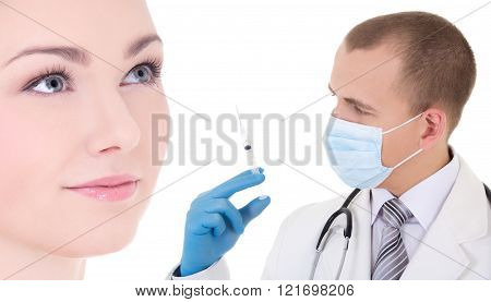 injection - doctor or beautitian in mask and blue gloves with syringe and woman patient isolate