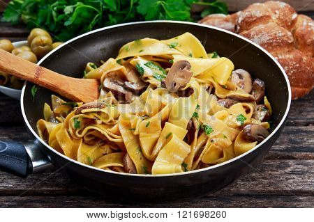 Pappardelle Pasta with mushrooms and other herbs in pan