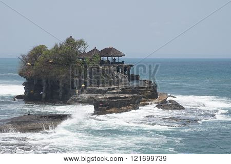 BALI, INDONESIA - SEPTEMBER 29, 2015: Tanah Lot temple during tidal water on September 29, 2015 in Bali, Indonesia