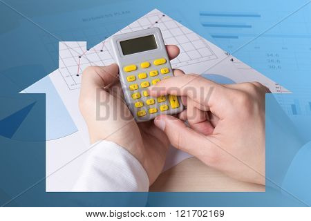 Real Estate Concept - Male Hands Accounting Something With Calculator