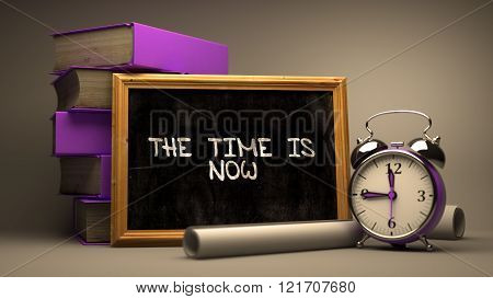 The Time is Now Handwritten on Chalkboard.