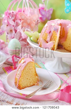 Easter Ring Cake With Pink Icing And Butterfly Shaped Sugar Sprinkles
