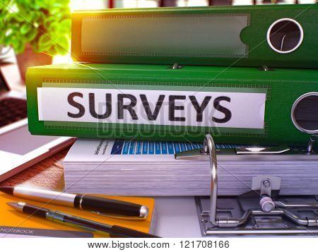 Surveys on Green Office Folder. Toned Image.