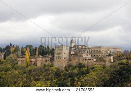 Alhambra Palace on cloudy sky in Granada - Spain.