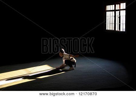 Boy practices martial arts
