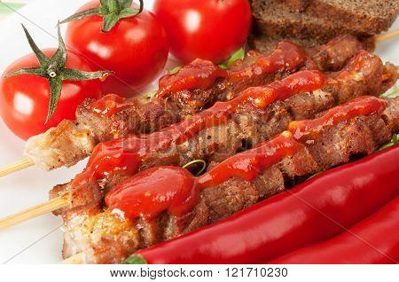 Shish kebab on bamboo sticks with cherry tomatoes