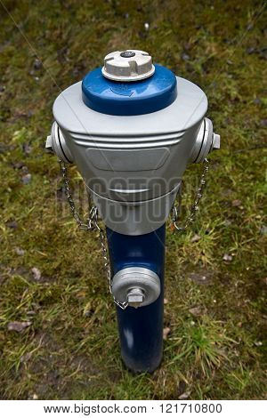 An isolated blue hydrant (standpipe) in the Zillertal, Austria.