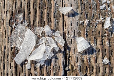 Pieces Of Shattered Ice On A Wood Surface