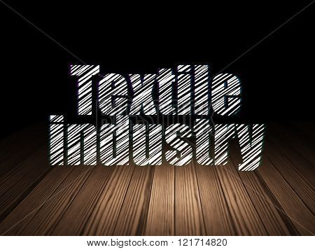 Manufacuring concept: Textile Industry in grunge dark room