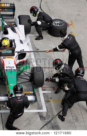 Sepang, MALAYSIA - 23 November: Tire change for team Mexico at the pits at the World A1 GP championship races held in Malaysia. 23 November 2008 in Sepang International Circuit Malaysia.